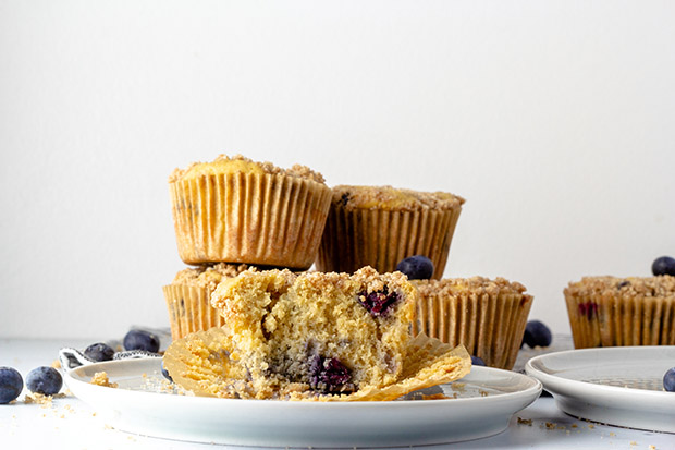blueberry muffins open on a plate